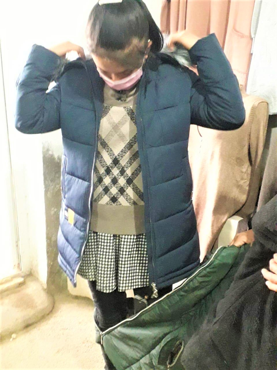 Deaf girl receives winter clothes